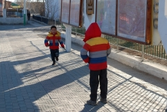 I loved watching these two brothers in matching jackets. I think kids are just the same all around the world. I'm not sure where these two were headed, but what you can't hear in the photo is the older (slightly annoyed) brother shouting at his younger sibling to hurry up.