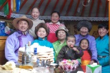 Family portrait - this time of my teacher Oyunzaya and her family. She and her husband are in matching lavender deels.