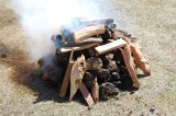 Getting the fire started with wood and dung. River rocks are added and once hot will be added to the khorkhog.