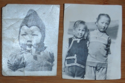 Left: Dashka as an infant, exact age unknown. Right: Dashka, age 7 with her sister Oyuntugs, age 4.